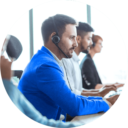 man wearing mask at desk