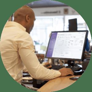 man validating deposits in portal