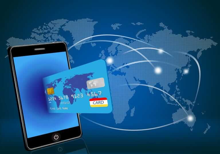 Illustration of a mobile device and credit card with a global map in the background