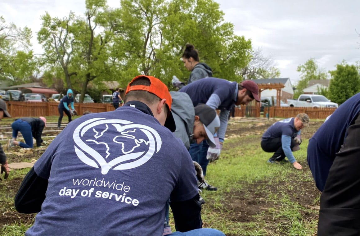 A group of volunteers planting in a garden