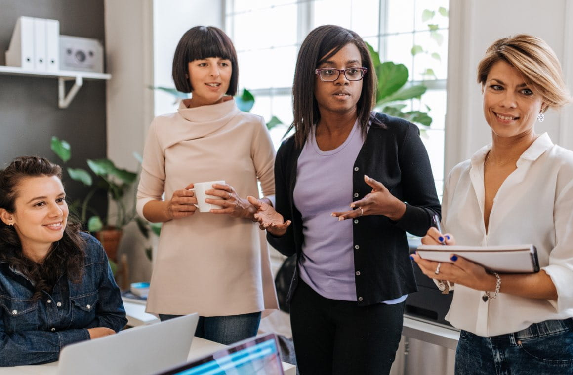 A group of women working in an office setting
