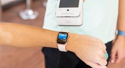 A customer making a payment via a watch