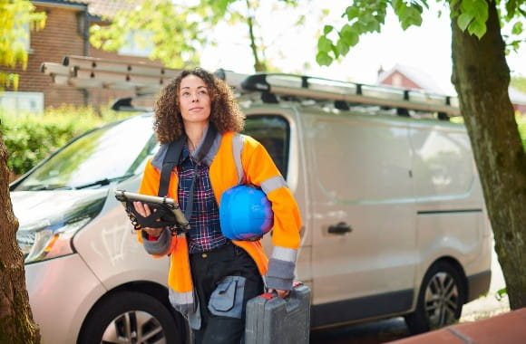 A handyman professional with equipment in her hands