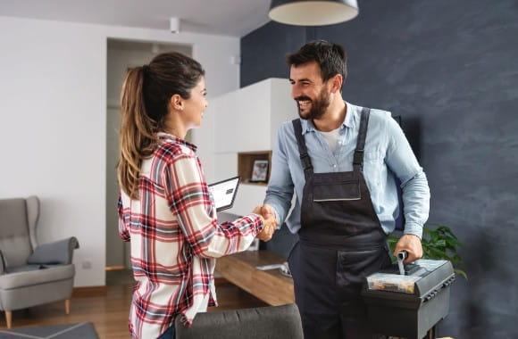 A handyman shaking a customer's hand