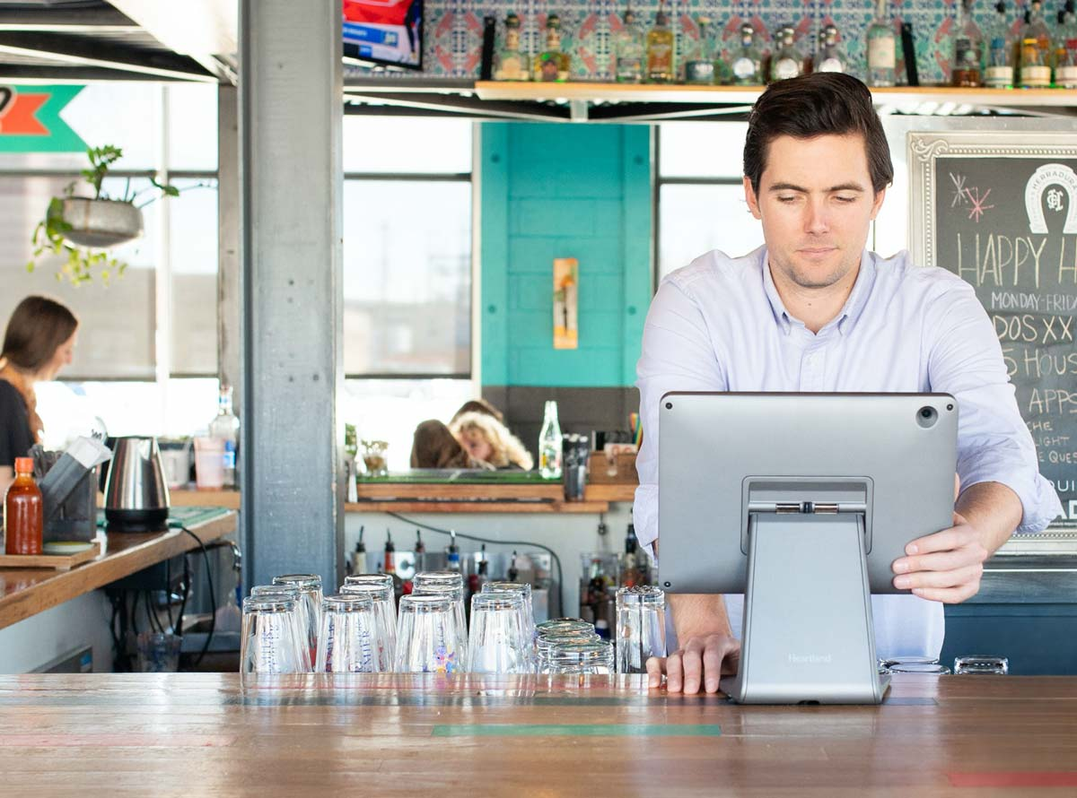 A bar staff member working on point of sale terminal