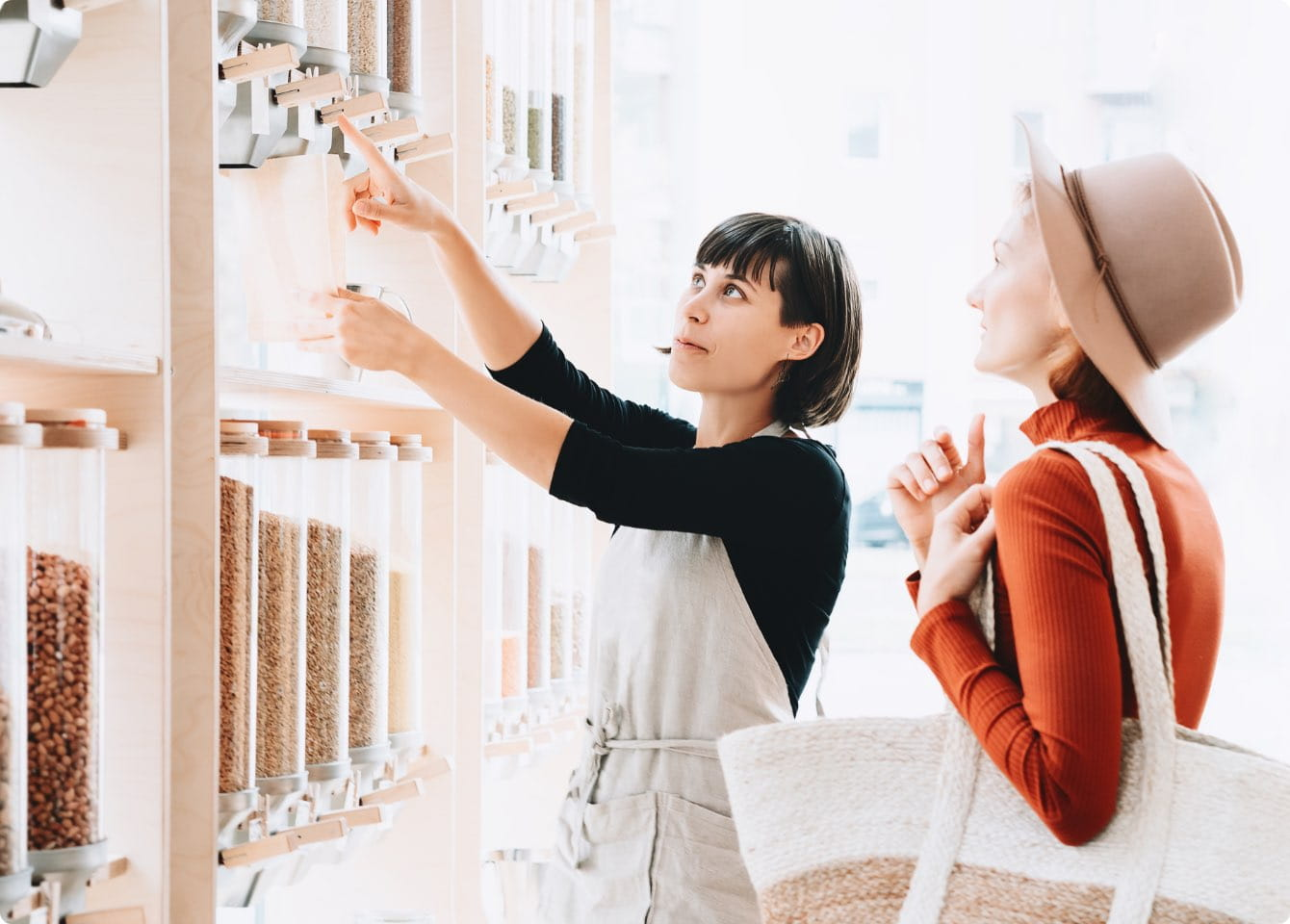 A clerk at a retail store getting a product for a customer