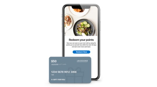 Close up of mobile device showing the info on how to redeem points with a gift card