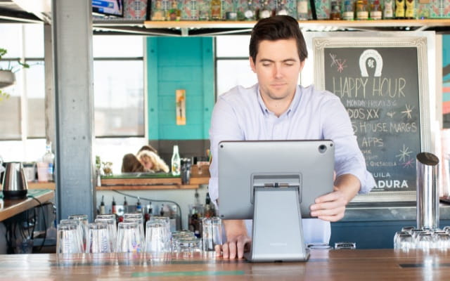 A bar worker on a point of sale terminal