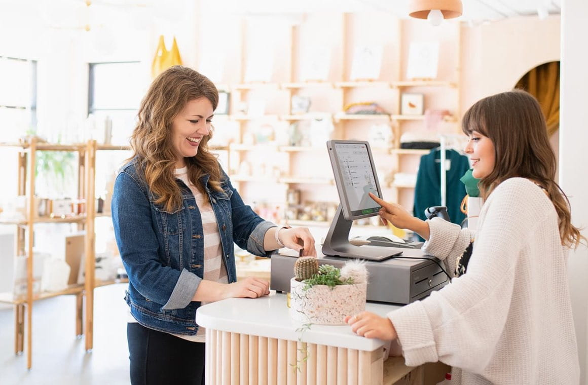 A customer making a credit card payment at a retail shop