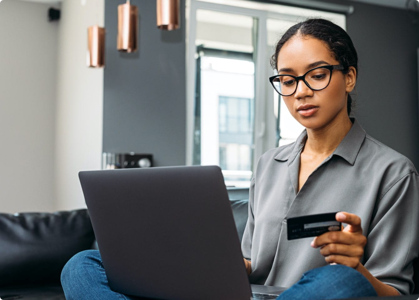 A woman on the laptop entering her credit card info for online payments