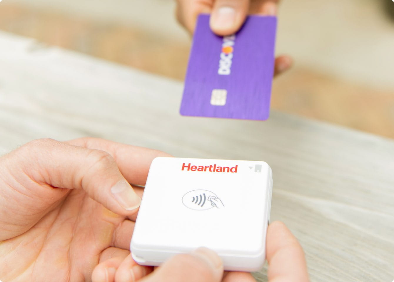 Credit card being inserted into mobile payment processing hardware