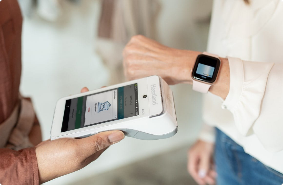 Close up of a POS device and digital wallet being used