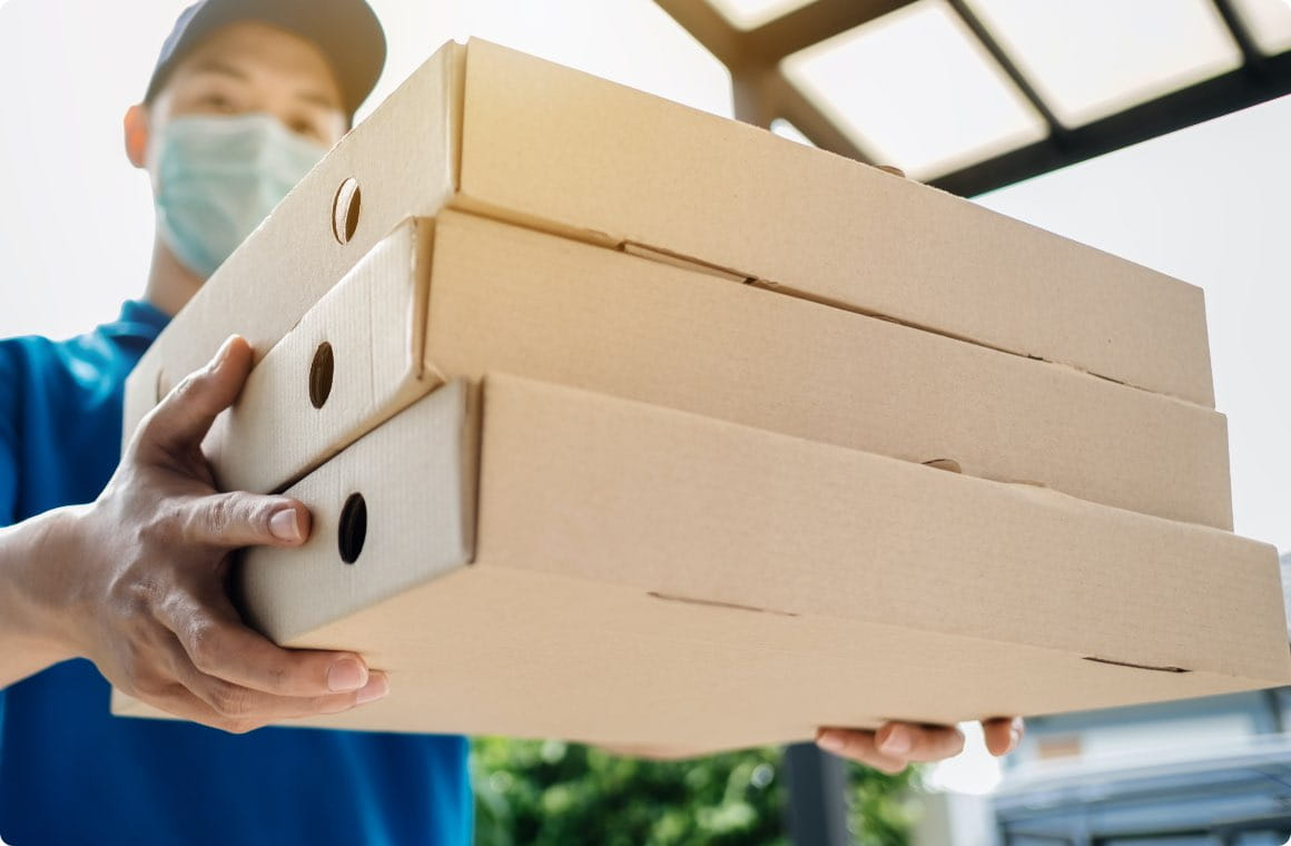 A man delivering pizza boxes