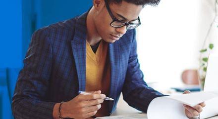 A man looking at notes