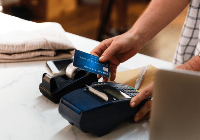 person making a payment with a credit card at a retail location