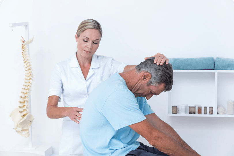 chiropractor adjusting a patient spine