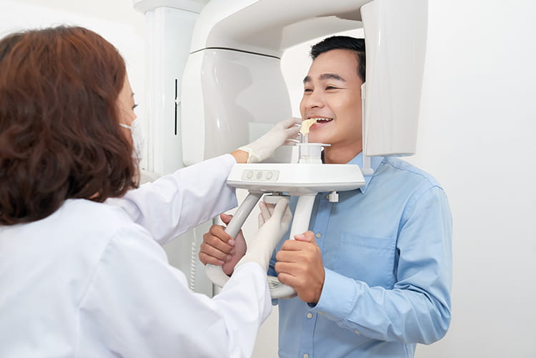 man getting x ray images taken at the dentist office