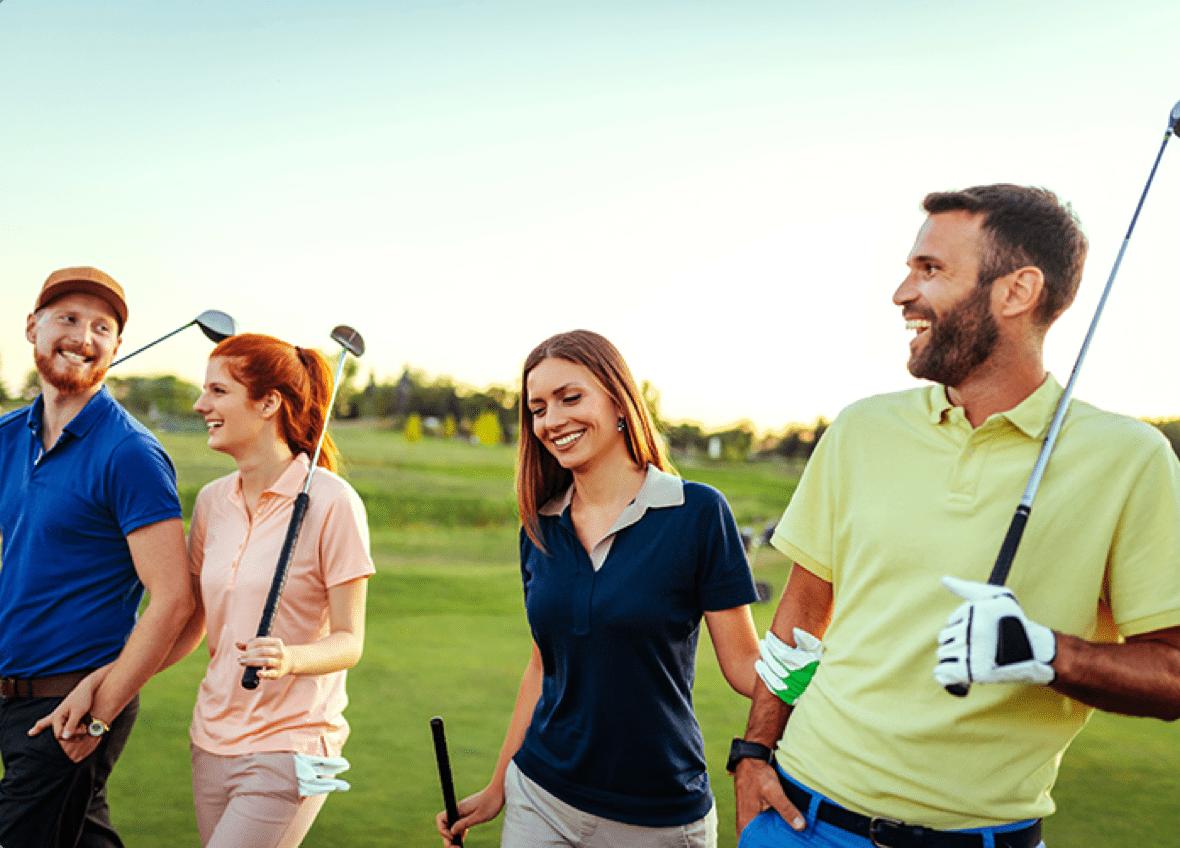 four friends golfing having fun